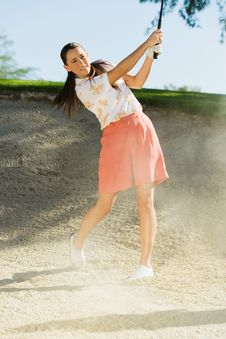 Free Female Golfer Hitting Ball Royalty Free Stock Photography - 13585027