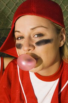 Softball Player Blowing Bubblegum Stock Images