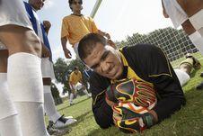 Free Goalkeeper On Ground Holding Soccer Ball Stock Image - 13585071