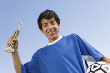 Free Soccer Player Holding Trophy And Ball Royalty Free Stock Photos - 13585108