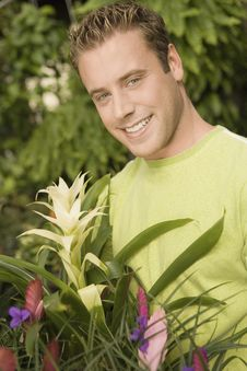 Free Young Man Holding Exotic Potted Plant Stock Photos - 13585113