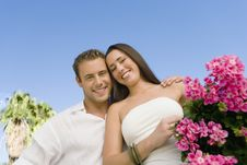 Free Young Couple With Potted Flower Stock Photos - 13585123