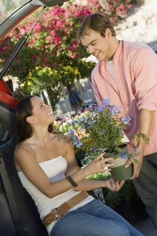 Free Couple With Potted Flower In Garden Centre Stock Image - 13585131