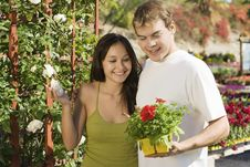 Free Young Couple Choosing Potted Flowers Royalty Free Stock Image - 13585136