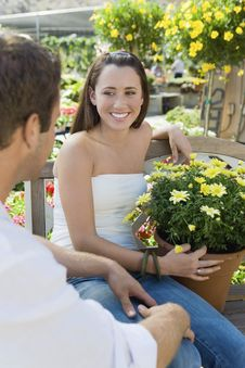 Free Young Couple Sitting On Bench In Garden Royalty Free Stock Photos - 13585148