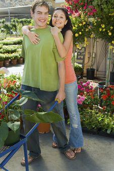 Woman Embracing Man With Pushcart Royalty Free Stock Image