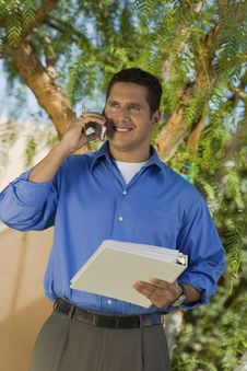 Free Buisnessman With Folder Talking On Mobile Phone Stock Photo - 13585160