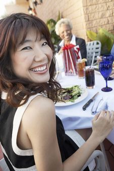 Smiling Woman Having Lunch With Friends Stock Image