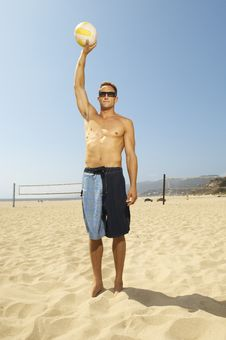 Volleyball Player Standing On Beach, Holding Vol Stock Images