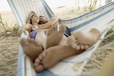 Free Young Couple Lying In Hammock On Beach Stock Photography - 13585212