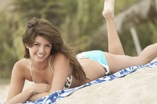 Free Young Latino Woman Lying On Beach Stock Photo - 13585220