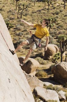 Free Climber Tugging On Rope On Cliff Stock Photos - 13585243