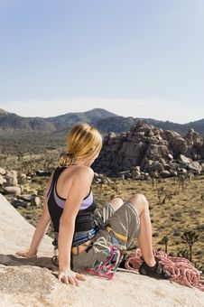 Free Climber On Rock Looking At Desert Royalty Free Stock Photography - 13585247