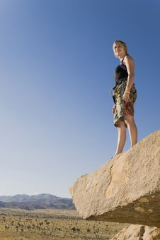 Free Climber Standing On Rock Looking At Desert Royalty Free Stock Images - 13585249