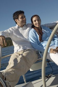 Young Couple Sitting On Sailboat Stock Photography