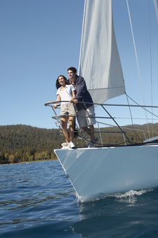 Young Couple Standing On Sailboat Royalty Free Stock Photography