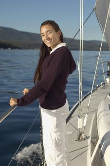 Free Young Woman On Sailboat Stock Photos - 13585283