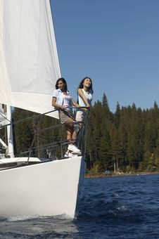 Two Young Women Standing On Sailboat Royalty Free Stock Image