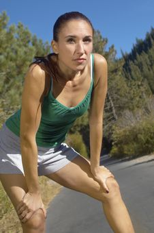 Female Jogger Pausing For Breath Royalty Free Stock Photography