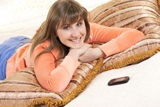 A Young Woman Is Lying On Her Bed Near Cellphone Stock Photo