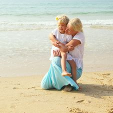 Little Girl With Her Mother On Sea Stock Images