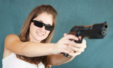 Free Girl In Sunglasses Aiming A Gun Stock Image - 13589641