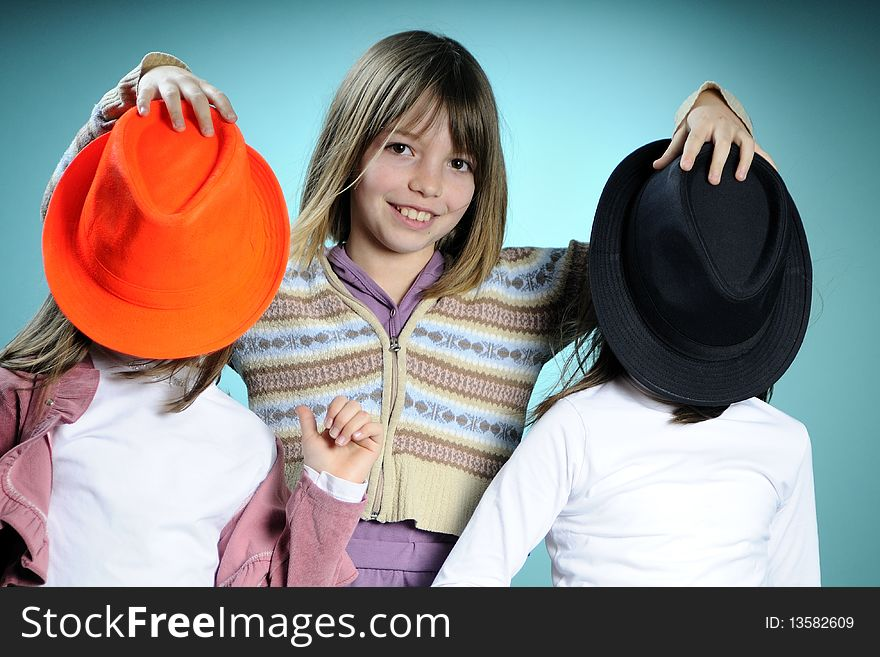 Three girls with colored accessories