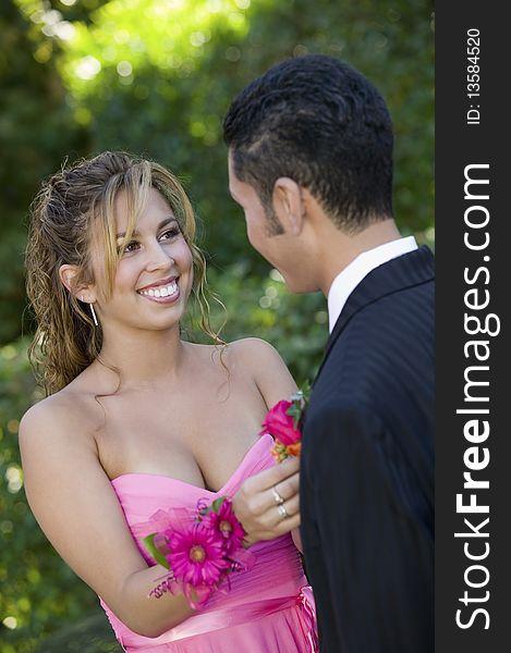 Teenage girl pinning boutonni�re on date