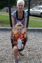 Free Playing On A Swing Royalty Free Stock Image - 13597956