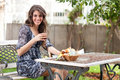 Free Young Woman Having Breakfast Outside Royalty Free Stock Photo - 13598465