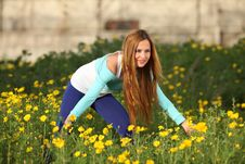 Beautiful Young Woman Standing In Blooming Meadow Royalty Free Stock Photo