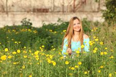 Free Beautiful Young Woman Sitting In Meadow Royalty Free Stock Image - 13591696