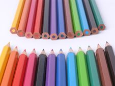 Rows Of Colorful Wooden Crayons Stock Photography