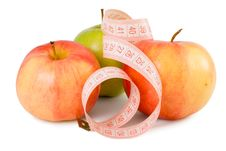 Free Pink Measuring Tape And Three Apples Royalty Free Stock Images - 13592349