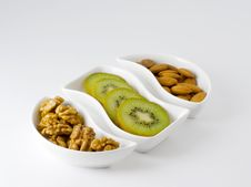 Kiwi Fruit And Nuts Royalty Free Stock Photography