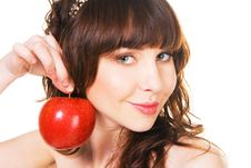 Free Lovely Young Girl Holding A Ripe Red Apple Stock Image - 13594001