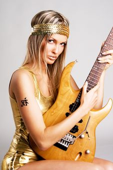 Free Golden Girl With Electric Guitar Stock Photography - 13594032