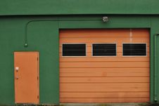 Two Doors: One For People, One For Cars Royalty Free Stock Photography