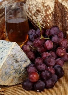 Food, Moldy Cheese And Red Grapes Royalty Free Stock Photo