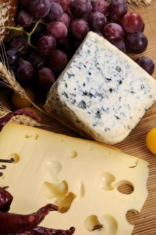 Food, Moldy Cheese And Red Grapes Royalty Free Stock Photos