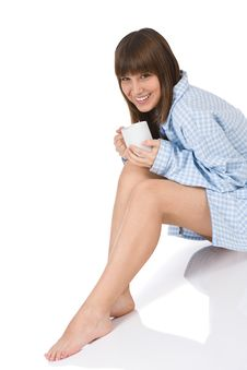Free Smiling Female Teenager With Cup Of Tea Royalty Free Stock Photography - 13597407