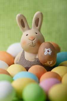 Free Easter Bunny Whit Many Colored Easter Eggs Stock Photo - 13597730