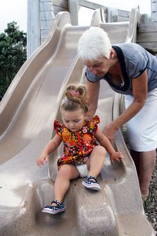 Free Playing On The Slide Stock Image - 13597931