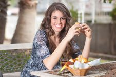Free Young Woman Having Breakfast Outside Stock Image - 13598211
