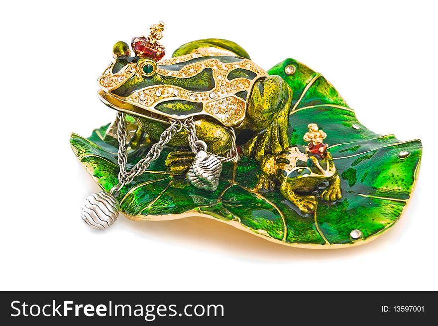 Frog- jewelry box with silver bracelet.