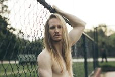 Free Selective Focus Photography Of Topless Man Holding Fence Stock Photo - 135955720