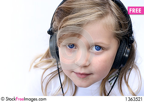 Free Young Girl Wearing Headphones Stock Image - 1363521
