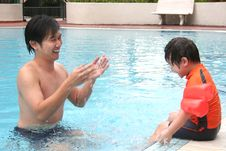 Free Man & Boy At The Pool Royalty Free Stock Photo - 1360255