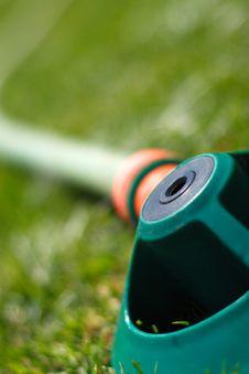 Free Hosepipe Sprinkler On Grass Stock Photo - 1361700