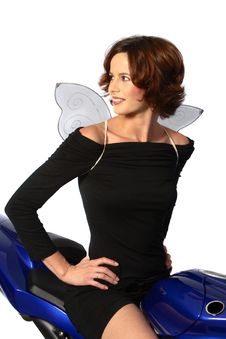 Free Brunette Girl On Motorcycle Black Dress And Wings Royalty Free Stock Image - 1362696